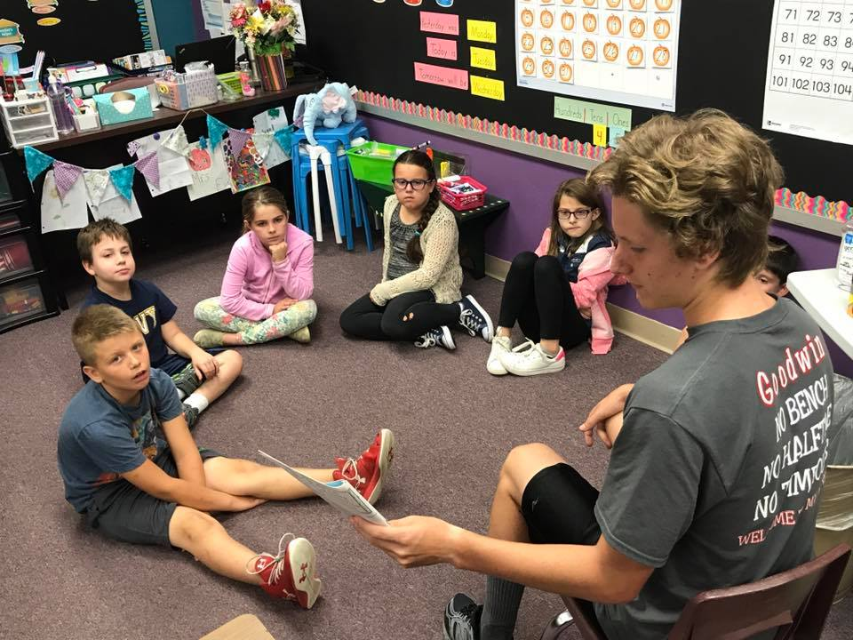Fall Sports Student-Athletes Reading to Elementary