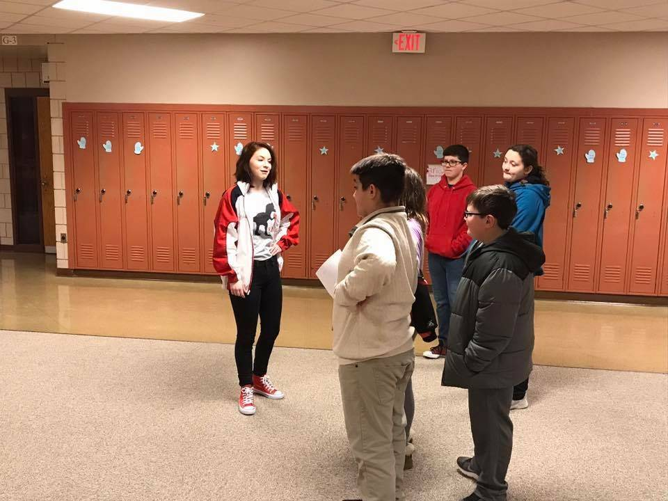 NHS Members giving incoming 7th grade students a tour of the building