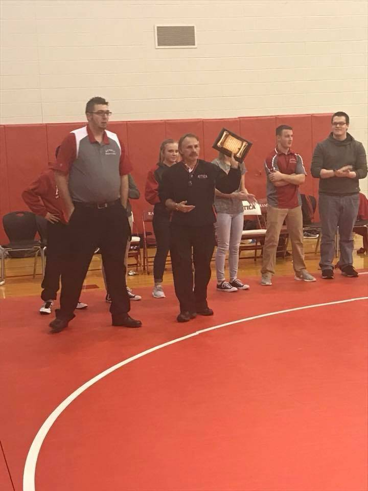Coach Branstetter receiving his plaque for his 500th win
